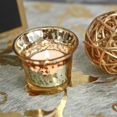 Ce photophore verre mercurisé or illuminera votre table de fête.  Sur une table, sa finition, très actuelle, renverra superbement la lueur de la bougie (effet photophore verre). Parfait pour un photopore noel !