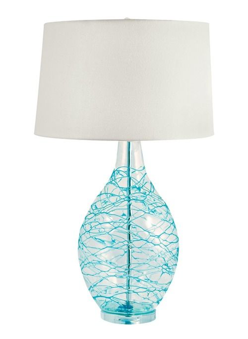 Slight imperfections in the blown glass lamp base with it's hand-applied, layered blue swirls of blue glass make this wonderful table lamp for any beach house.