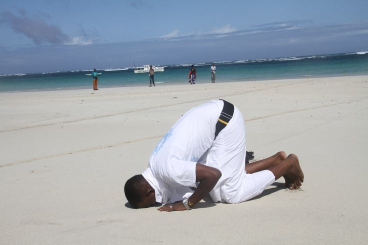 Africa-Somalia-Traditions-Culture:  Ali Arbush in prayer at Liido beach, he was in Traditional Dressing event.