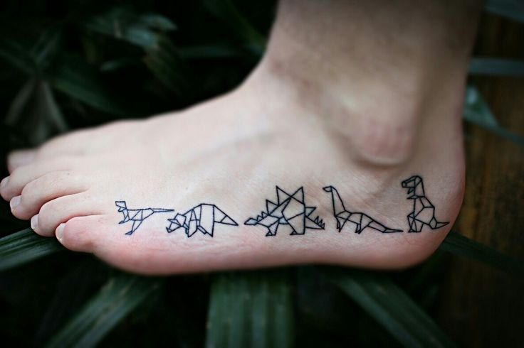 So happy with these guys! #tattoo #dinos #dinosaur #origami #foot