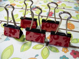 "decorate your own binder clips with your own style...these are covered in paper but fabric is good too! from ""a crafting corner in our universe"" blog"