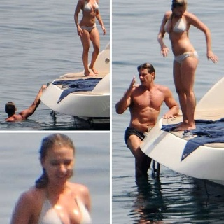 ";) Bikini Superhero It's no secret what Scarlett Johansson's super powers are ... looking ridiculously hot in a sexy wet bikini.  The 27-year-old showed off her Black Widow curves while on a yacht in Italy with a super buff man friend on Monday.  Here's rock solid proof why Scarlett is worth every penny of the $20 million she's reportedly banking for the ""Avengers"" sequel."