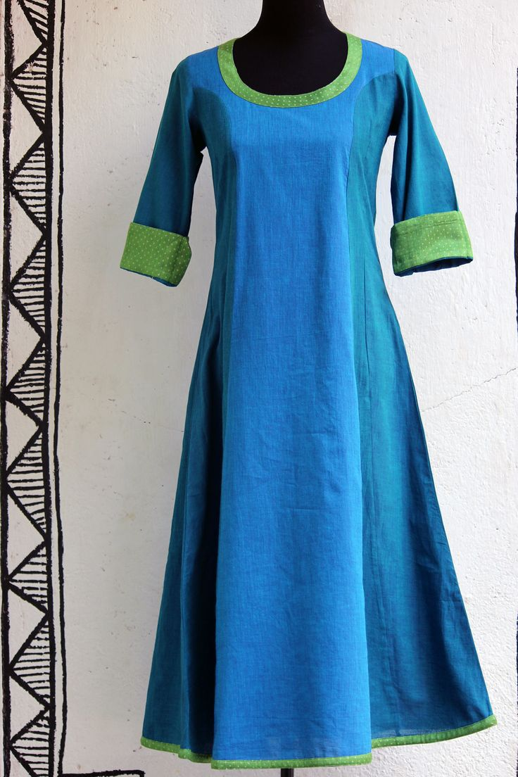 a stunning blue-green anarkali with handloom mashroo trims makes it a perfect for all occasions! it can be teamed with a variety of dupattas and stoles! (clic