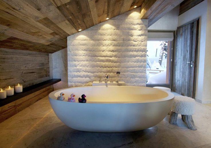 Stylish rustic bathroom with modern white tub. #KBHome