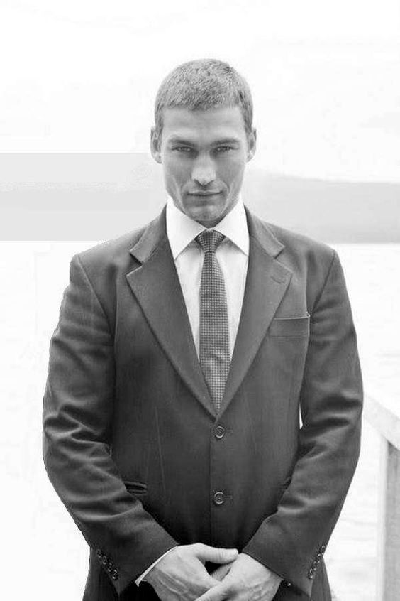 a young Patrick Stewart in a black suit (1960s)