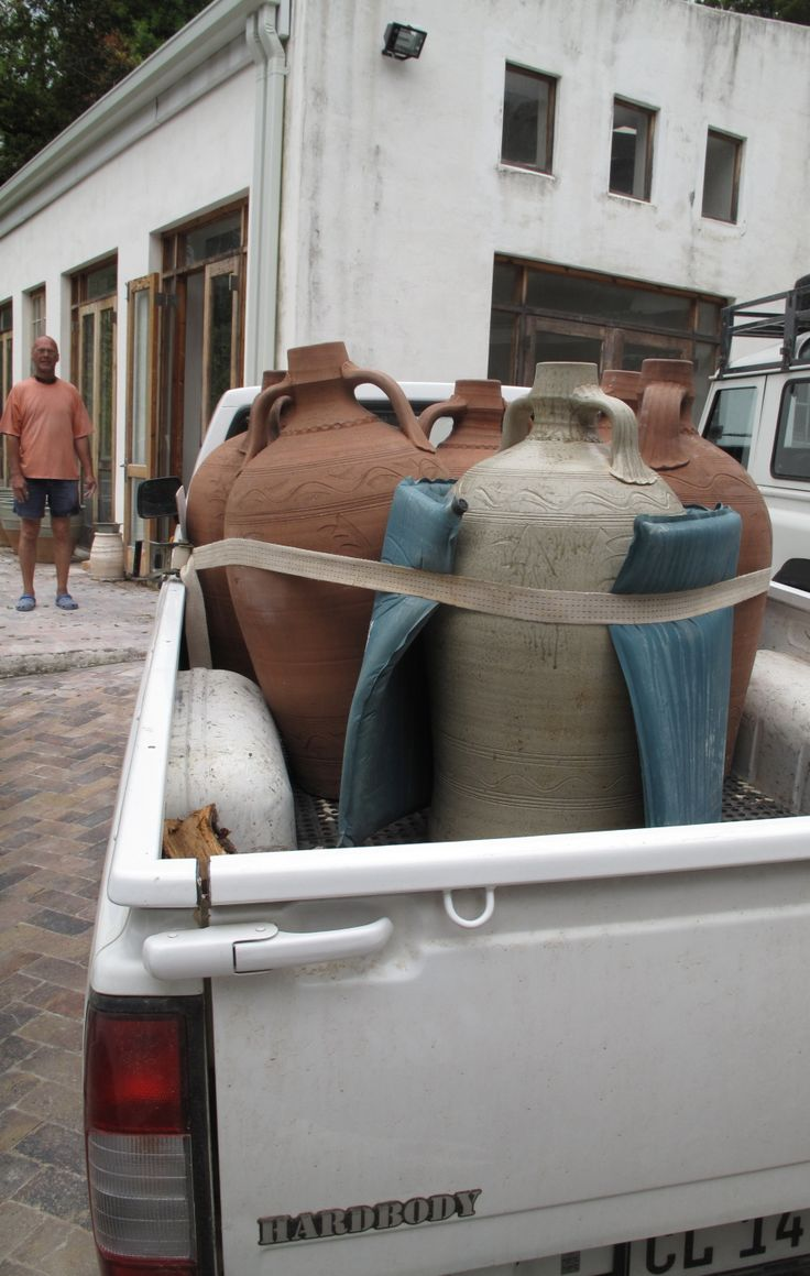 Nico Liebenberg at Longkloof Pottery with a load of wine jars