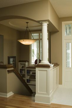 Nice half column at top of stairs.