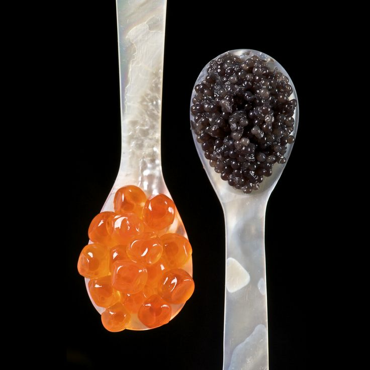 Salmon roe (left) and sturgeon caviar (right) served with mother of pearl caviar spoons to avoid tainting the taste of the caviar. Description from revolvy.com. I searched for this on bing.com/images