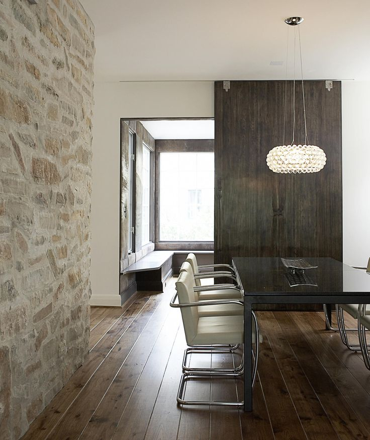 modern home with natural stone dining room wall | http://www.interioranddecor.com/