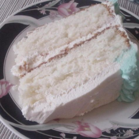 This is the best white cake I have ever tasted, so moist and has a wonderful flavor. It reminds me of a wedding cake. I use Madagascar Bourbon Vanilla which is in my opinion the best. I always use milk but if you prefer you can use water. You can add any flavor you want maybe a dash of almond if you like. It does take a little longer to bake I have gone as long as 40 minutes, it depends on your oven and pan size. It is very easy to work with, I cool mine on a wire cookie rack that I spray…