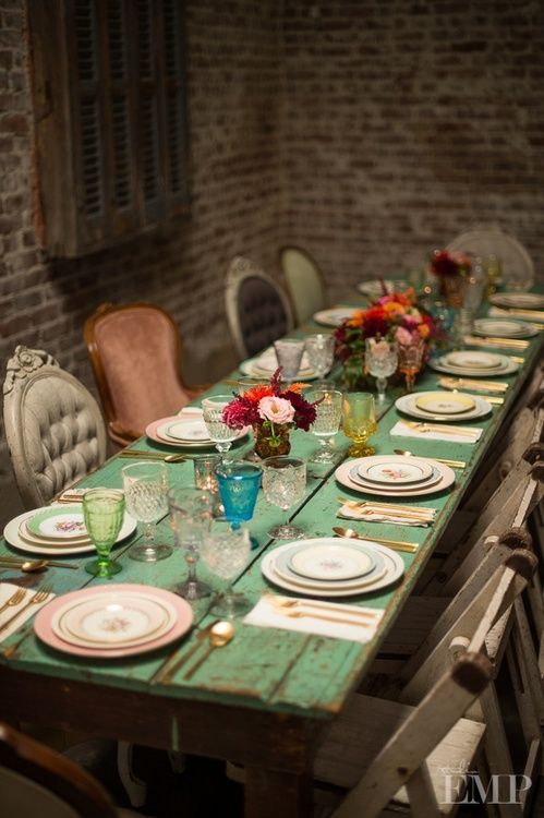 dining room. LOVE the antique chairs and colored wood table. #color #texture #different