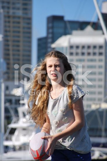 Girl plays Rugby against an Urban Scene royalty-free stock photo