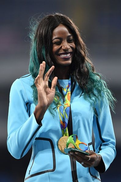 Gold medallist the Bahamas's Shaunae Miller celebrates on the podium for the…