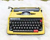 Working typewriter Student in VERY GOOD working condition Yellow typewriter Made in Japan Qwerty keyboard Lightweight typewriter