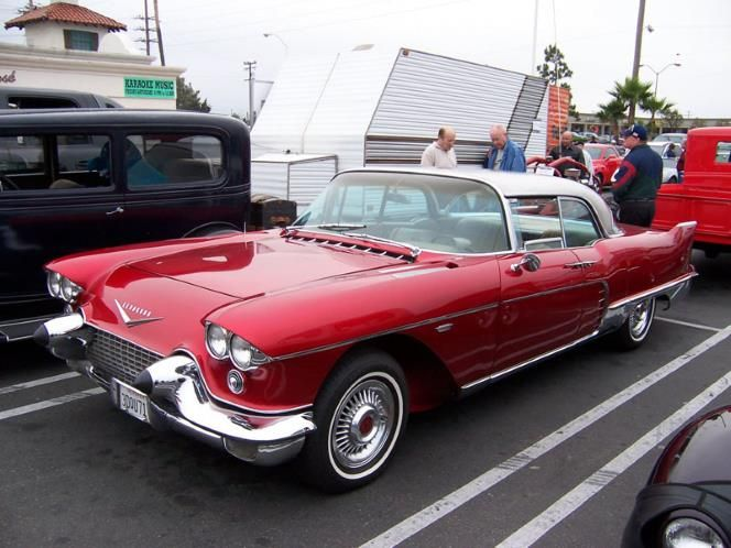 1958 Cadillac Brougham in RED. A great combination of sophistication and sport for the discerning gentleman