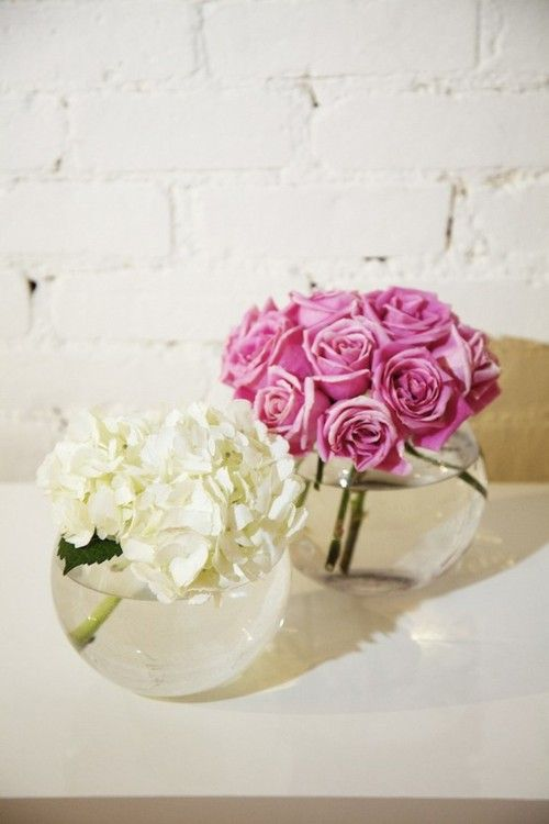 Centerpiece inspiration- love how these round bowls give so much interest to the flowers