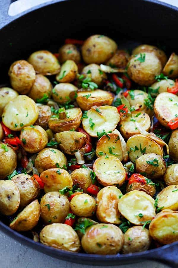 French Roasted Potatoes Easy Recipe With Baby Potatoes Onion And Bell Peppers This French Sty Potato Side Dishes Easy Dinner Recipes Crockpot Onion Recipes