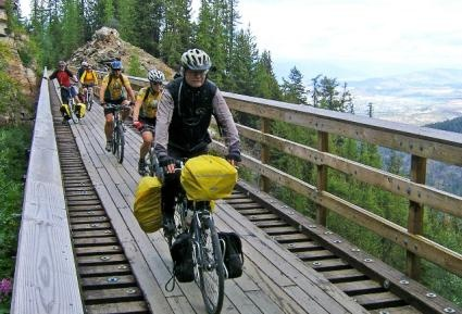 Biking along the Trestles - Kelowna: Every year, over 60,000 visitors enjoy the spectacular Myra Canyon trail which follows a section of the historical Kettle Valley Railway (KVR) over 18 trestles and through two tunnels. This well maintained, relatively level trail offers spectacular views of the Canyon and the distant Okanagan Lake.