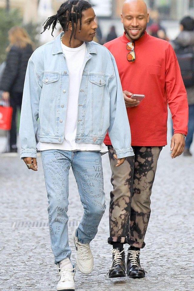 ASAP Rocky wearing  Guess 1990s Vintage Denim Jacket, Gucci Scribbled writing print punk pant, Jordan 1985 Metallic Blue Sneakers