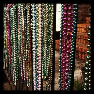 Great way to decorate with extra Mardi Gras beads!
