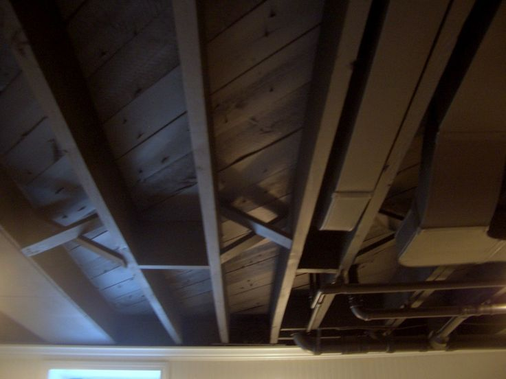 Instead of putting up dry-wall or a drop-ceiling, we took an easier approach, and it come with many benefits! It gave us higher ceilings, th...
