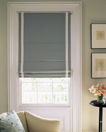 This wall which includes Roman Shades is an example of a soft, light modern setting. With our antique look i think I prefer a slightly deeper shade..