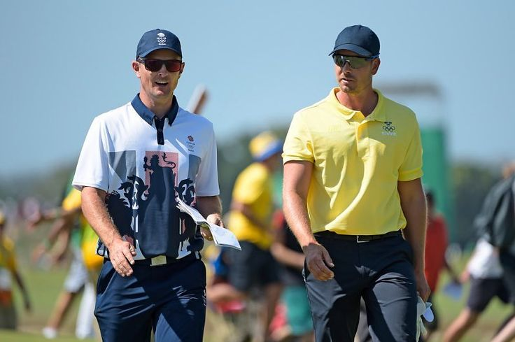 Justin Rose of Great Britain and Henrik Stenson of Sweden walk to the third tee during final round of the the Rio 2016 Olympic Games at the Olympic Golf Course on August 14 2016 in Rio de Janeiro Brazil. (Photo by Chris Condon/PGA TOUR/IGF) http://ift.tt/2aWe8Hc
