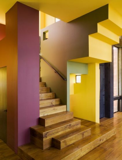 Blocks of color, rather than architectural elements, help to define this staircase from the back.