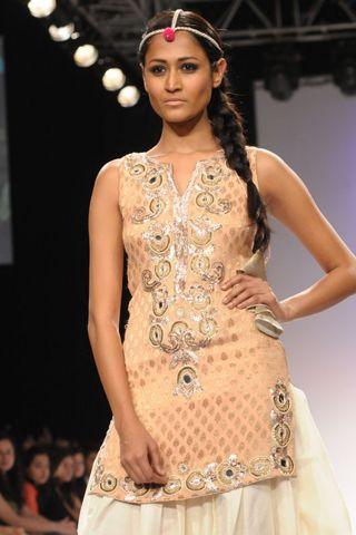 Blush Banarsi Lotus Embroidered Kurta worn with Silk Jodhpurs. SHOP THE LOOK AT http://www.payalsinghal.com/off-the-runway/blush-banarsi-lotus-kurta