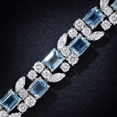 A truly gorgeous platinum, aquamarine and diamond bracelet, circa 1950s-1960s, by the great American jewelry manufacturer - Oscar Heyman. Eighteen deep pastel blue emerald-cut aquamarines (about as fine a color as they come in smallish sizes) are embraced by 9.00 carats of colorless, high-quality marquise and round brilliant-cut diamonds in this sparkling, wonderful and refreshing mid-century vintage jewel.