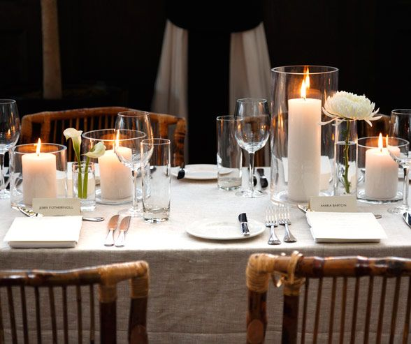 Pillar Candles In Thin Gl Hurricanes Enhance This Setting S Minimal Rustic Decor