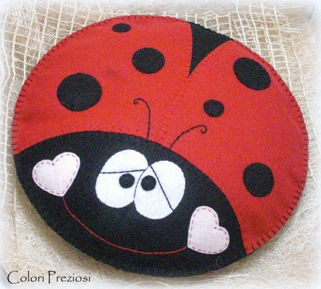 Red and black smiling ladybug: felt pillow for baby pijamas