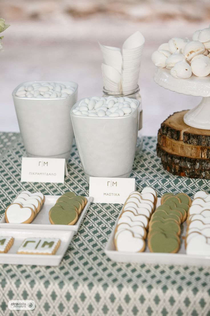 Rustic wedding in the countryside. Olive and white color palette. Candy bar with cookies and meringue drops.