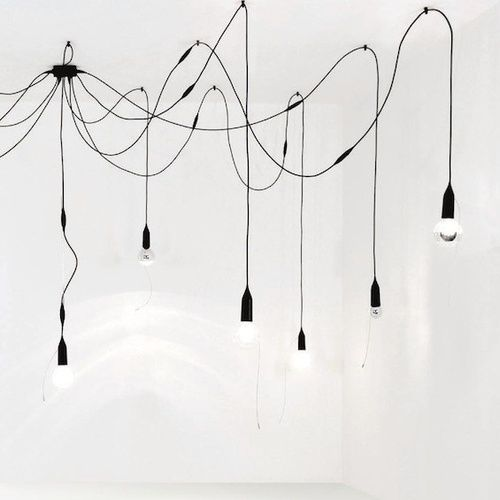 Chandelier of dangling lights l light bulbs hanging from black cords