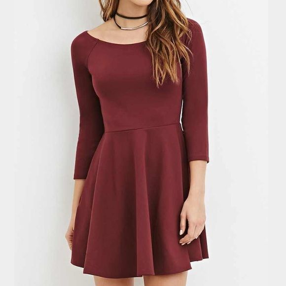 Wine Colored dress new New wine colored dress with mid sleeves and a flare bottom size large Forever 21 Dresses