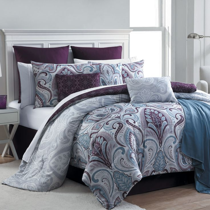 Stage a fabulous boudoir in seconds with an Essential Home 16-Piece Bedrose Comforter Set in plum. The updated large-scale damask pattern in purple, mauve and blue adds contemporary flair to your bedroom. Complete with sheets, shams, accent cushions and a throw, this gorgeous ensemble makes it easy to create a fashionable and comfortable bed in no time.