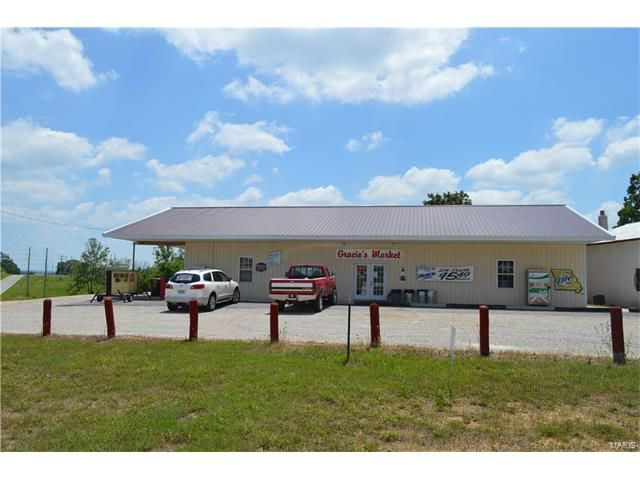 Newer Metal Building in a good location with Hwy frontage on both sides. Slab foundation and about 3,200 + Sq. Ft. currently a store business ( refrigeration equipment included) + An additional 30X40 older building and all sitting on about 7 Acres with Highway frontage. Call for more details in Lebanon MO