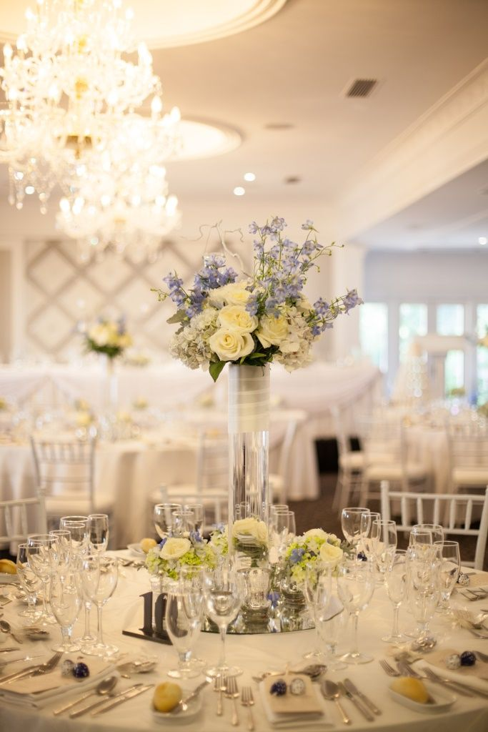 Tall floral centrepieces www.touchedbyangels.com.au