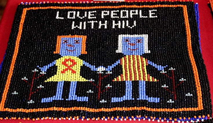 Cool beaded mat urging viewers to love people with HIV