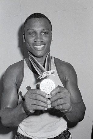 Golden boy: A young Frazier shows off his Olympic medal from the 1964 Tokyo Games