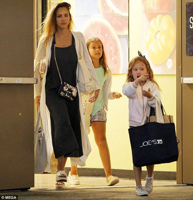 Bumping along: Pregnant Jessica Alba showed off her growing bump as she ran errands with her daughters Honor, nine, and Haven, five, at Whole Foods in Beverly Hills on Monday evening
