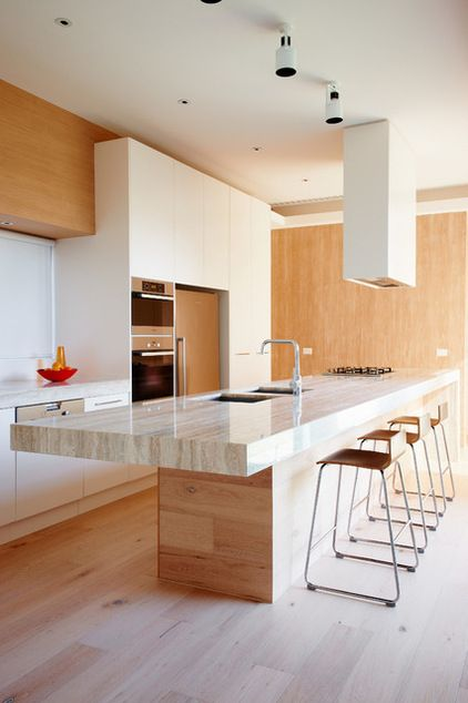 Modern Kitchen by David Edelman ArchitectsLimestone David Edelman Architects has created the most amazing kitchen benchtop using travertine limestone with a thick nosing that gives the impression of solidity. Once again the colour of the vein has been picked up to select the appropriate natural timber and stools to complement the stone and create a glowing warmth in the space.
