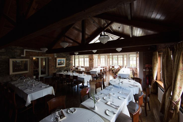 The old and new spaces connect freely, with character-filled beams giving way to an airy glass ceiling in the furtherest end of the Garden Room. Table arrangements to accommodate 120 can be created. Olde Post Inn, Cloverhill, Co. Cavan, Ireland.