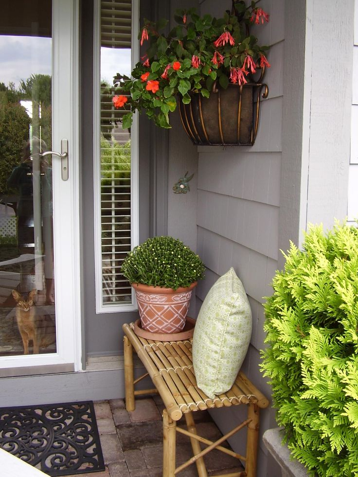25 best ideas about small porch decorating on pinterest for Front porch landscaping plants