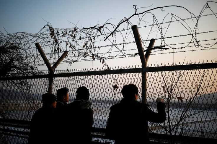 South Korean guards fired warning shots across the heavily militarized border with North Korea on Thursday as a soldier from the North defected in thick fog, complicating efforts to ease tensions over Pyongyang's nuclear and missile programs.
