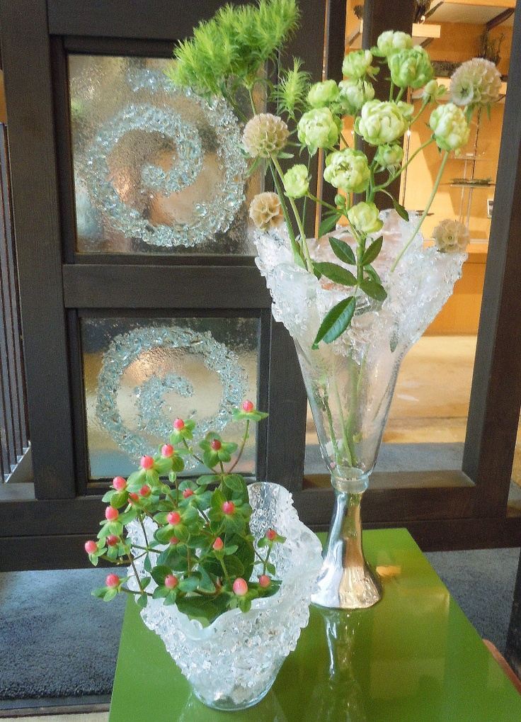 Flower vases for centerpieces. Designs by Glass Studio