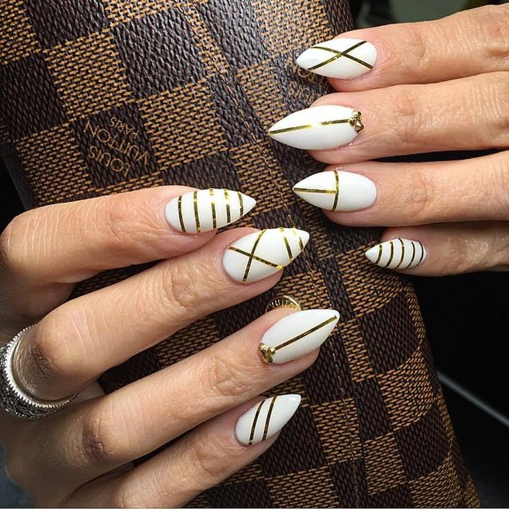 white with gold tape lines nail