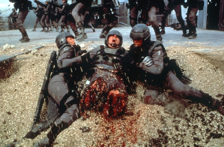 8/10/17   12:07a  Tri-Star Pics  ''Starship Troopers''  Tanker Bug Emerges  from Underground Chomping on SGT's Legs Released: 1997