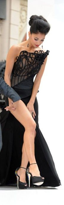 Nicole Scherzinger dons a stylish and sexy high front split Cengiz Abazo?lu Couture dress