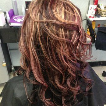 Base chocolate with red and blonde highlights. Had this done before thinkin bout doing it again.